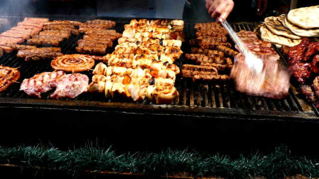 Romanian traditional sausages (mici), skewers and grill steaks video