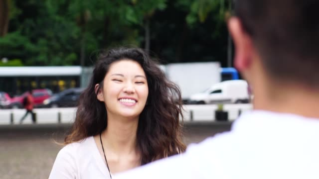 romantic asian couple meeting/hugging - chiedere scusa video stock e b–roll