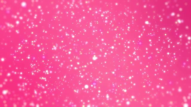 輝く粒子とロマンチックな背景 - ピンク色点の映像素材/bロール