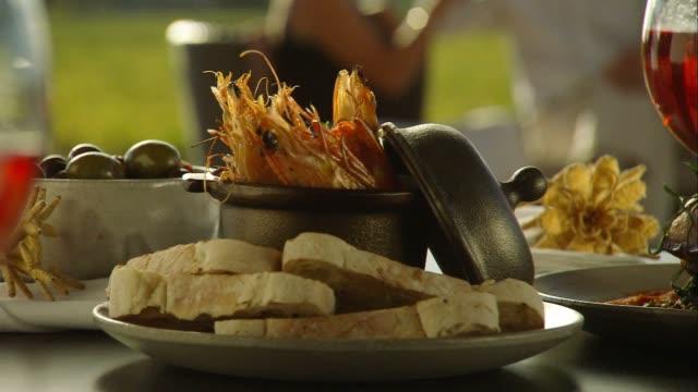 Romantic couple alfresco fine dining in winery vineyards video