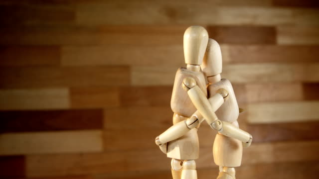 Romantic couple figurines embracing each other video