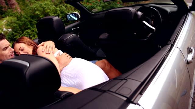 Romantic couple in a convertible car