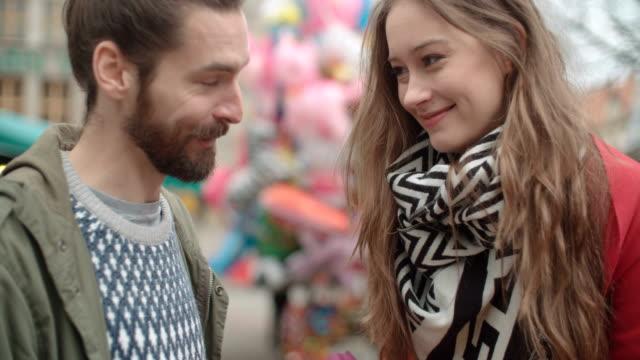romantic couple meeting in a city. man giving woman bunch of flowers. - para aranżacja filmów i materiałów b-roll