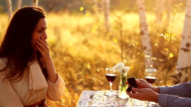Romantic Couple Proposal in Forest at Sunset video