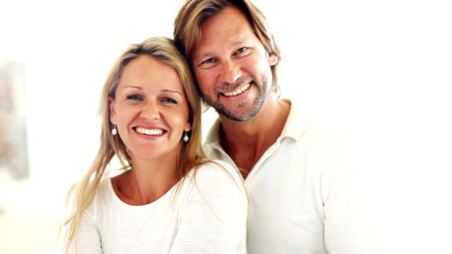 Romantic couple smiling Closeup of an embracing romantic couple human relationship stock videos & royalty-free footage