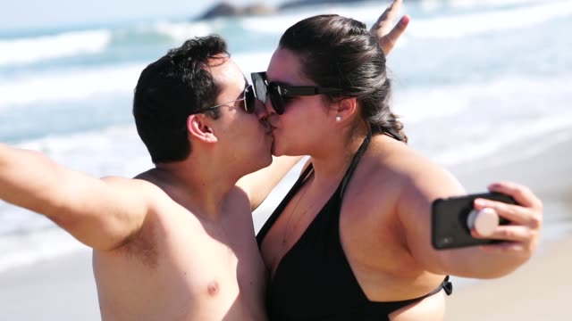 Romantic Couple Taking a Selfie on the beach Self Portrait plus size model stock videos & royalty-free footage