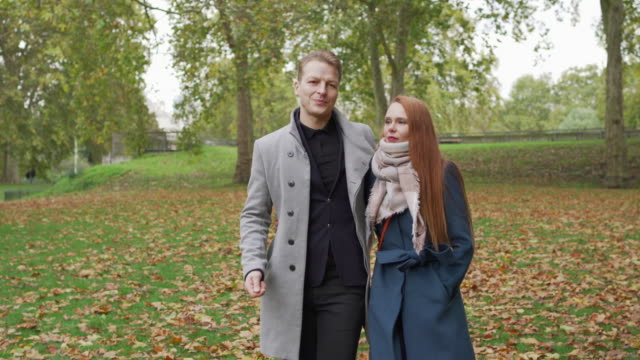 a romantic couple walking through a park together - true love angielski zwrot filmów i materiałów b-roll