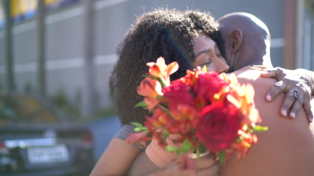 Romantic couple with flowers embracing Romantic couple with flowers embracing anniversary stock videos & royalty-free footage