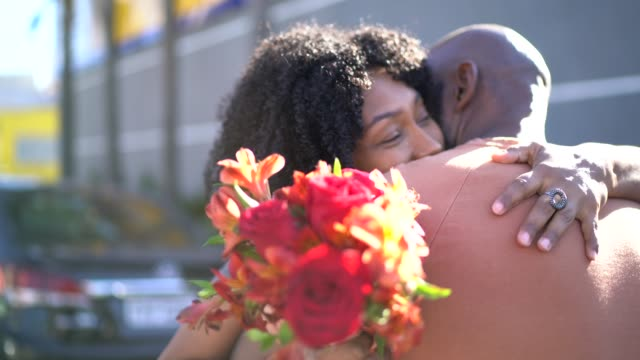 Romantic couple with flowers embracing