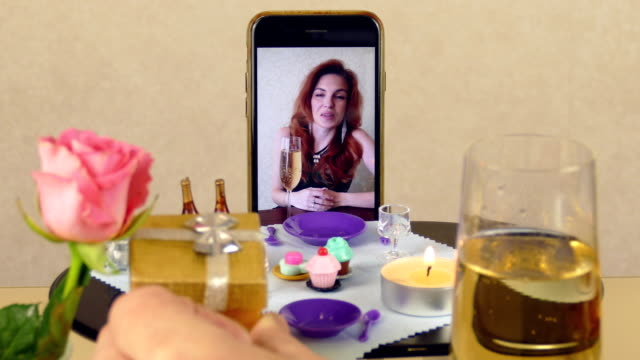 romantic date and gifts at the doll table using a smartphone for video calling video