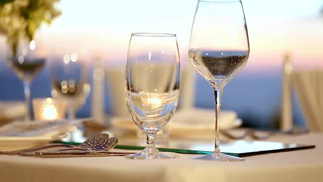 Romantic dinner table setup at restaurant. video
