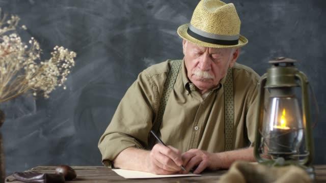 Romantic Elderly Man Writing Handwritten Letter