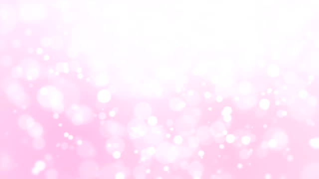 Romantic light pink bokeh background Beautiful romantic pink glowing bokeh background with floating light particles. pink color stock videos & royalty-free footage