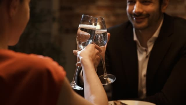 romantic loving couple having a dinner date and toasting - date night stock videos & royalty-free footage