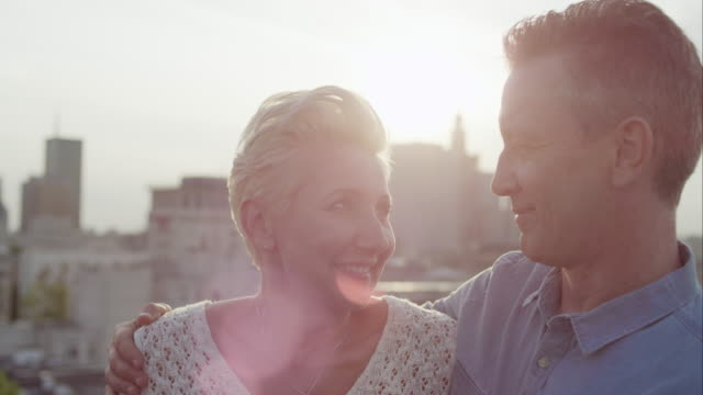 Romantic middle age couple smiling video
