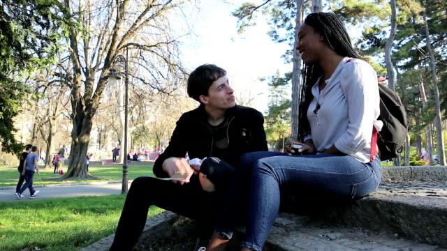 Romantic, mixed race couple outdoors