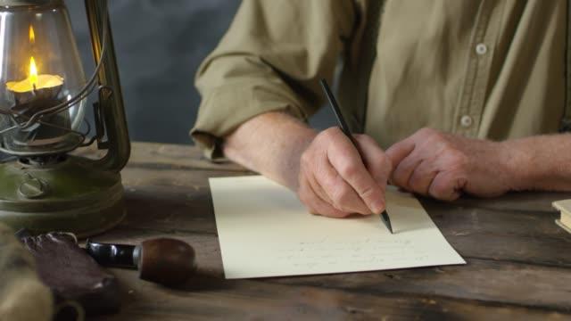 Romantic Old-Fashioned Elderly Man Writing Poem