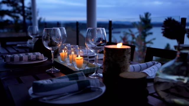 Romantic seaside restaurant at sunset - video