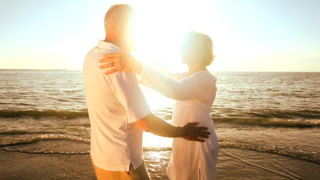 Romantic Senior Couple Dancing on the Beach video