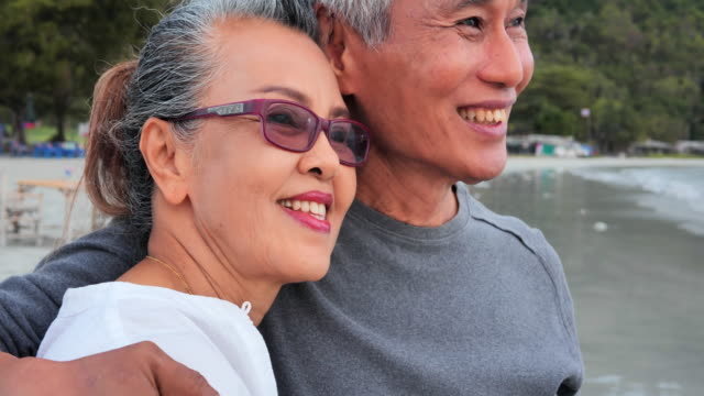 Romantic senior couple hugging on summer vacation.Senior couple relaxing by the sea.Senior Holidays,Vacations - vídeo