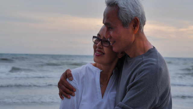 romantic senior couple on summer vacation.senior couple relaxing by the sea.senior holidays,vacations - sud est asiatico video stock e b–roll