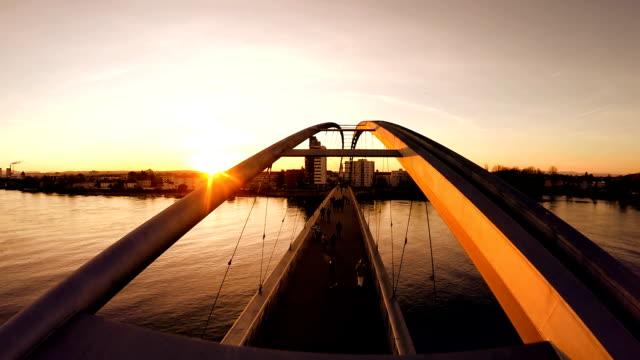 romantic sunset background. aerial view of futuristic bridge. way of life video