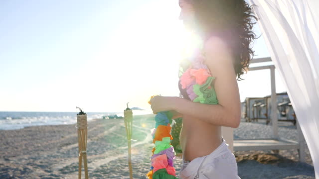 Romantic vacation for loving couple by sea, Hawaii lei are put on neck of guy and girl, Sunny beach tropical island for young video