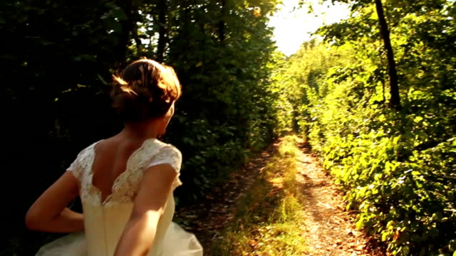 romantic wedding concept bride holding hand forest walking - wedding fashion stock videos and b-roll footage