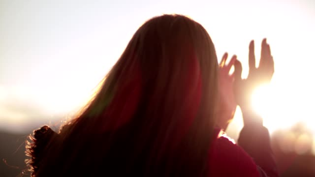 Romantic woman playing with the light of the sun video