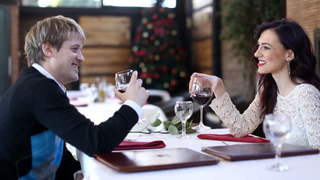 Romantic young couple in the restaurant (HD) video