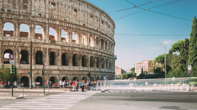 Rome, Italy. Colosseum. Traffic Near Flavian Amphitheatre. Famous World Landmark UNESCO. – film