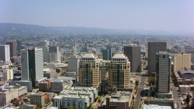 AERIAL Ronald V. Dellums Federal building and the center of Oakland, California Aerial shot off the center of Oakland California in the Ronald V. Dellums Federal building. Shot in the USA. oakland stock videos & royalty-free footage