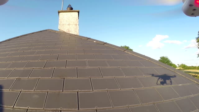 Roof inspection with a drone Roof inspection with a drone. quality control stock videos & royalty-free footage