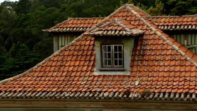 Roof of ancient house covered with old peeled red tile, cozy attic at home Roof of ancient house covered with old peeled red tile, cozy attic at home dormir stock videos & royalty-free footage