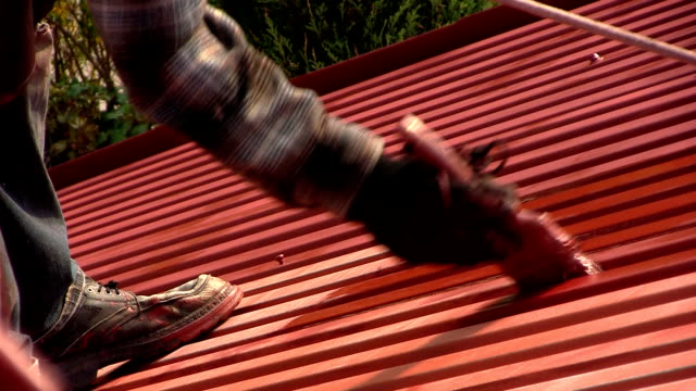 Roof painting close-up video