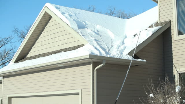 Roof Rake Removing Winter Snow video
