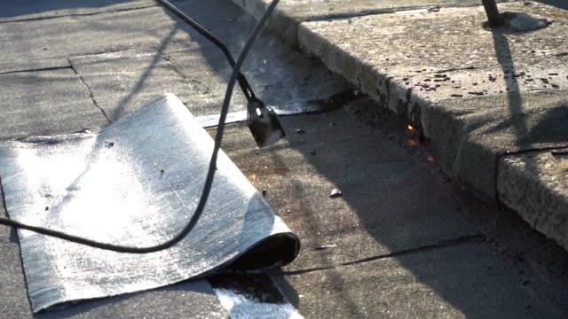 Roofer melts the bitumen video