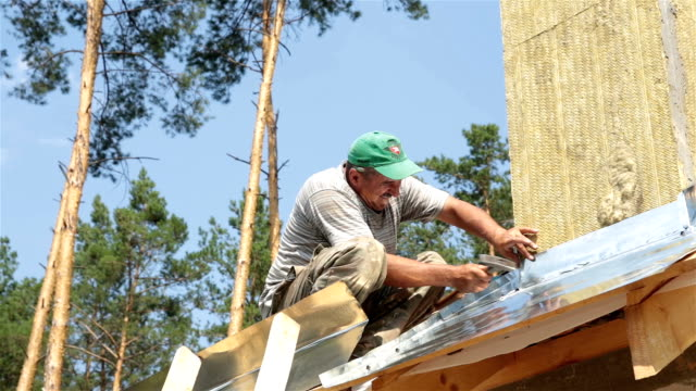 Roofer works on the roof. video