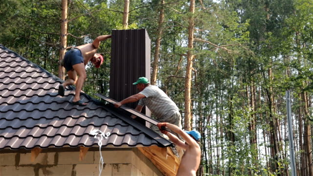 Roofers build the roof. video