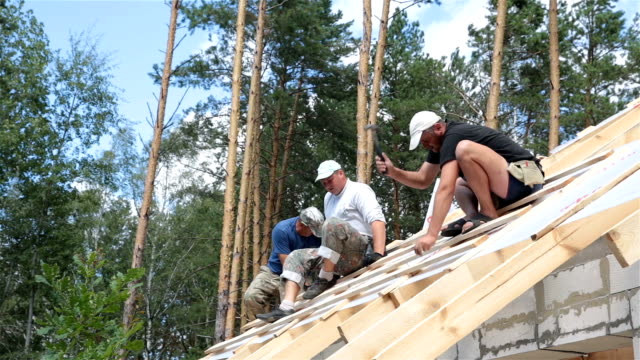 Roofers work on the roof. Construction of the roof. video