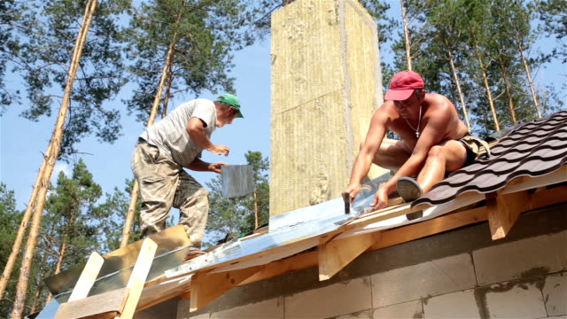 Roofers work on the roof. video