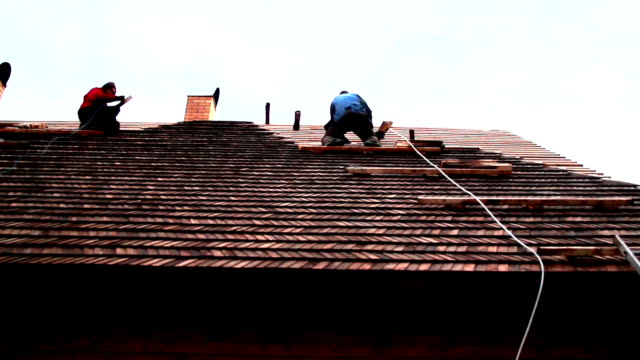 Roofers working on the roof video