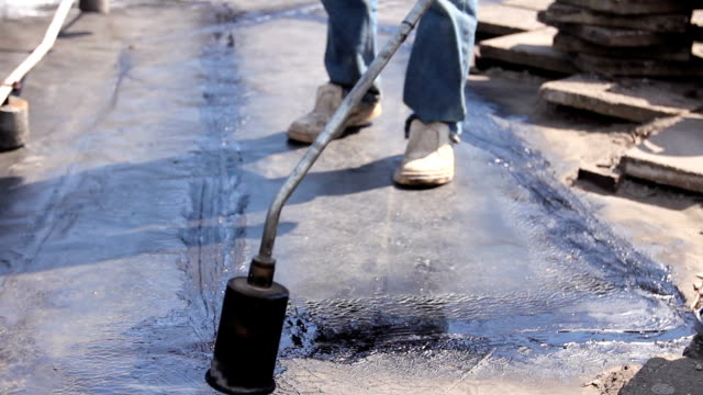 Roofing installation resin with propane blowtorch using a gas burner video
