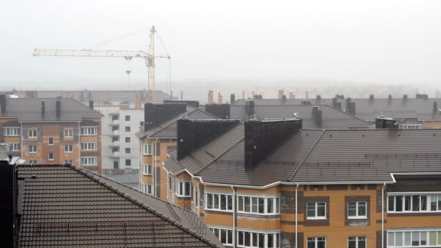 Roofs multi-storey Apartment houses covered by fog video