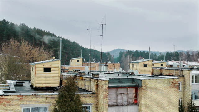 Roofs of slummy suburb area. Smoke from chimney video