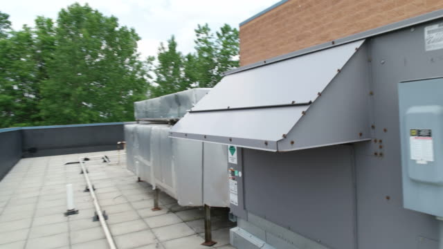Rooftop HVAC equipment as camera moves past video