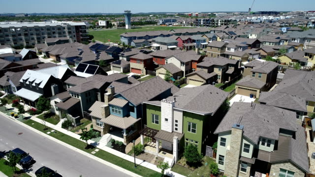 rooftops covered with solar panels aerial drone view above east austin , texas , usa high above solar panel suburb community - house aerial stock videos & royalty-free footage