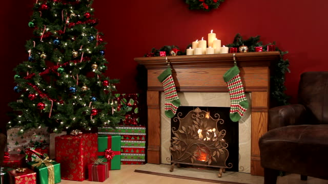 Room decorated for Christmas Room decorated for Christmas, candles and fireplace burning living room stock videos & royalty-free footage
