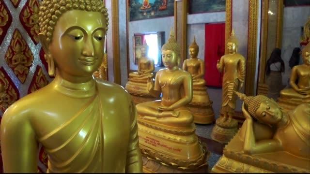 room of golden buddhas, wat chalong, phuket - верующий стоковые видео и кадры b-roll