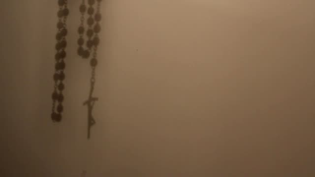 rosary shadow on the wall video